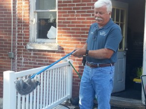 Dan Crider from D and R Pest Control removes the unwanted visitor from the KSLQ/KWMO Studios.